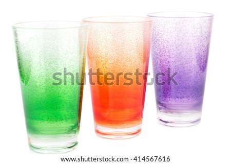 Colorful plastic glasses isolated on white background. - stock photo