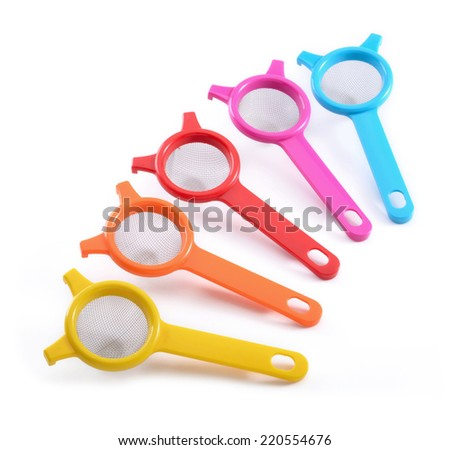 colorful plastic kitchenware Strainers - stock photo