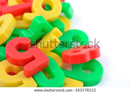 Colorful plastic numbers on white background