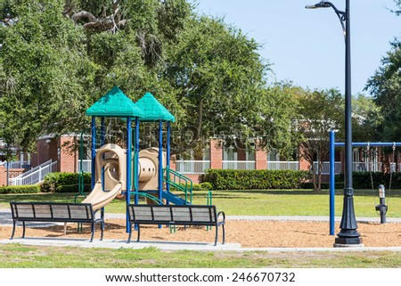 Colorful plastic playground equipment in a park - stock photo