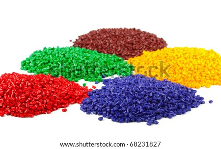 Colorful plastic polymer granules isolated on white - stock photo