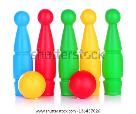 Colorful plastic skittles of toy bowling isolated on white