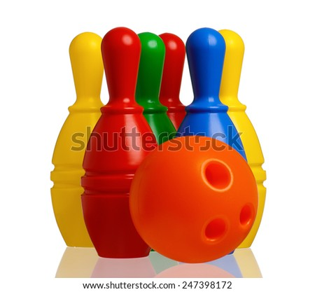 Colorful plastic skittles of toy bowling with orange ball isolated on a white background - stock photo