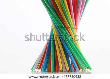 colorful plastic straw on the white background