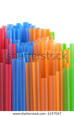 Colorful plastic straws with copy space - stock photo