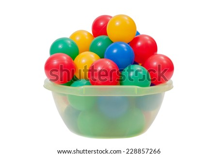 Colorful plastic toy balls into green washbowl - stock photo