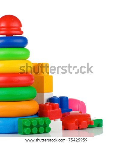 colorful plastic toys and bricks isolated on white background