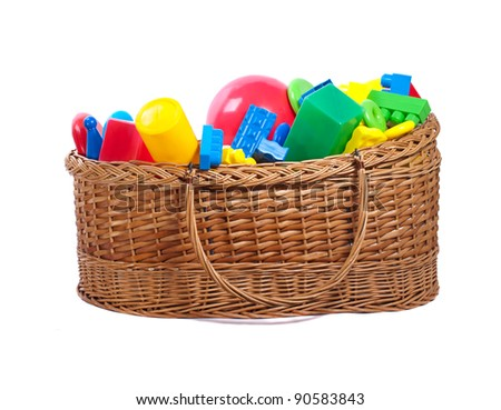 Colorful plastic toys in a basket isolated on  white background.
