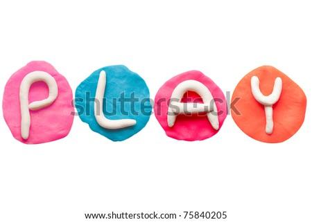 Colorful plasticine alphabet form word PLAY - stock photo