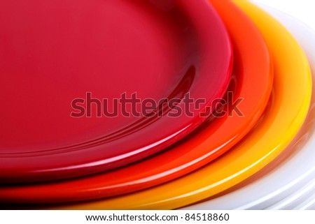 Colorful plates stacked one above the other - stock photo