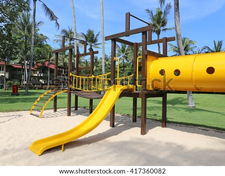 colorful playground at a tropical resort - stock photo