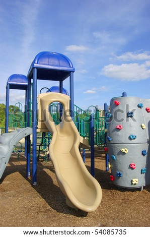 Colorful playground equipment on a sunny day - stock photo