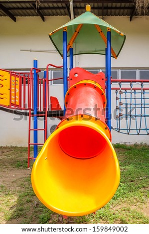 Colorful playground equipment on the playground - stock photo