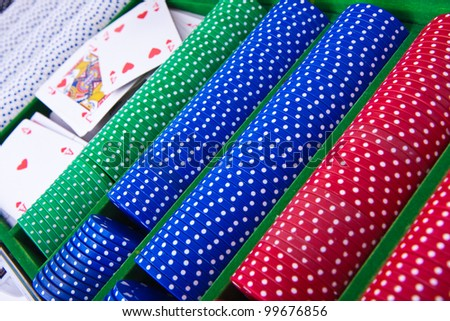 colorful poker chips with ace card - stock photo