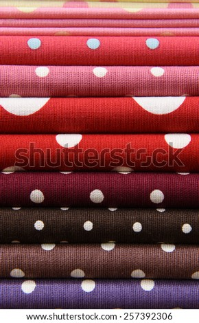 Colorful polka dot fabric for background - stock photo