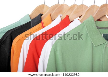 colorful polo shirts on hangers - stock photo
