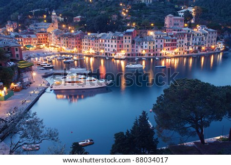 Colorful Portofino fishing village at dusk in Liguria, Italy - stock photo