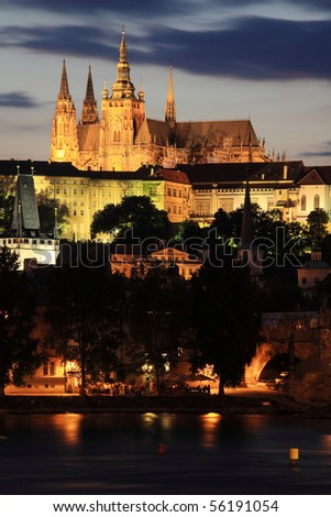 Colorful Prague gothic Castle above the River Vltava in the Night - stock photo