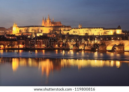 Colorful Prague gothic Castle above the River Vltava with Charles Bridge in the Night, Czech Republic - stock photo