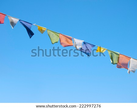 Colorful prayer flags over a clear blue sky in Sikkim, India