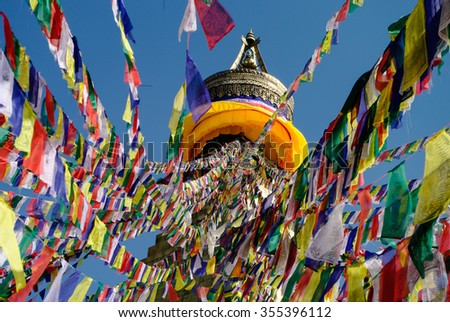 Colorful praying flags and buddhist stupa in sunlight in Nepal. Stupa Bodnath, Kathmandu