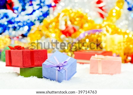 colorful present boxes over snow
