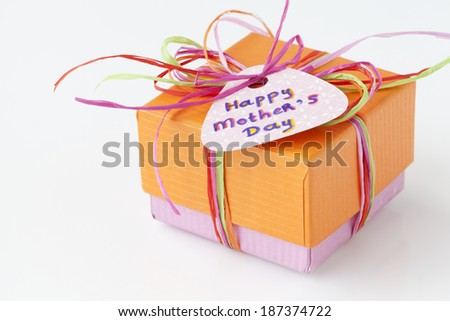 Colorful present with a card for Mother's Day on a white background