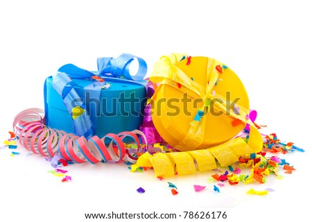 Colorful presents with serpentine and party streamers isolated over white background
