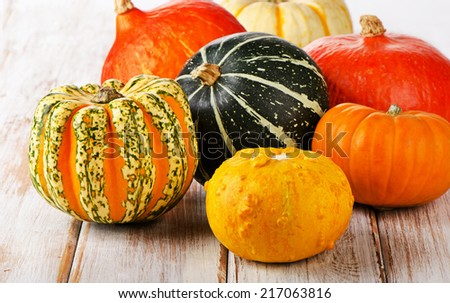 Colorful pumpkins on a wooden table. Selective focus  - stock photo