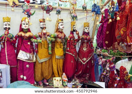 Colorful puppets hanging in the shop, India - stock photo