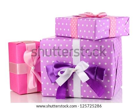 Colorful purple and pink gifts isolated on white - stock photo