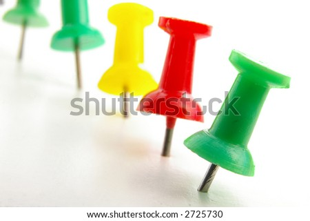 Colorful push pins in a line, closeup