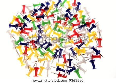 Colorful push-pins over white background