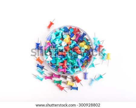 colorful push pins set with shadows isolated on white - stock photo