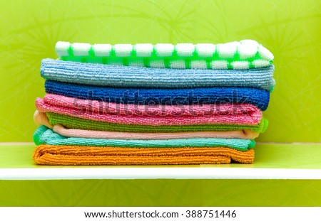 Colorful rags or hand towels pile. Early spring cleaning or regular clean up. - stock photo