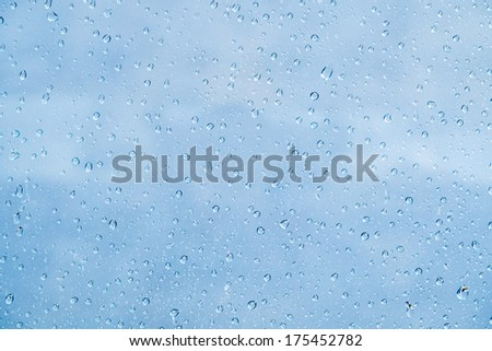 Colorful rain drop on window  - stock photo