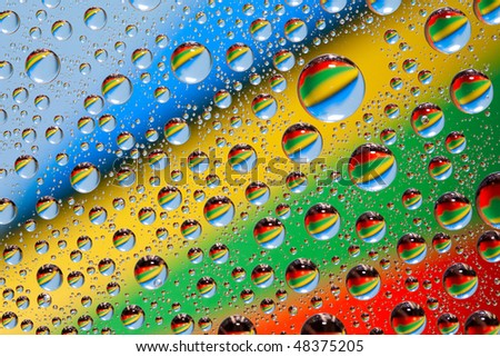 Colorful rain drops. Water collection. - stock photo