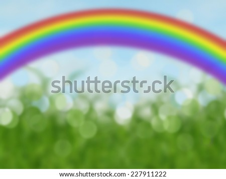 colorful rainbow abstract bokeh background with grass and blue sky - stock photo