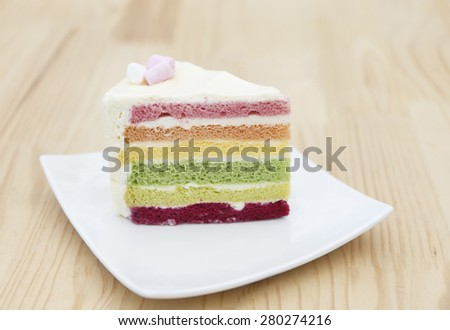 colorful rainbow cake top with marshmallows  - stock photo