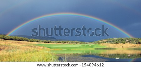 Colorful rainbow in Heber Valley, Utah, USA. - stock photo