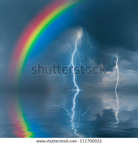 Colorful rainbow over water, thunderstorm with rain and lightning on background - stock photo