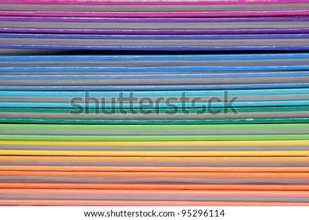 Colorful rainbow real books as background - stock photo