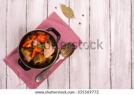 Colorful ratatouille with veal steak. Top view. Selective focus - stock photo