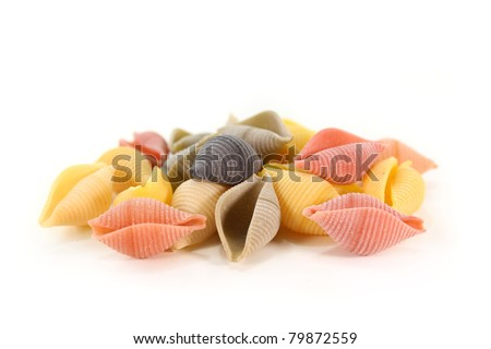 colorful raw pasta on a white background