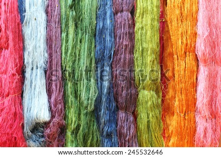 Colorful raw silk thread in the silk farm - stock photo