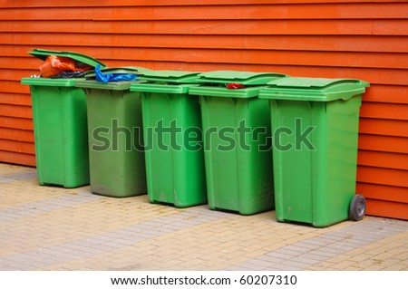 Colorful Recycle Bins near the wall - stock photo