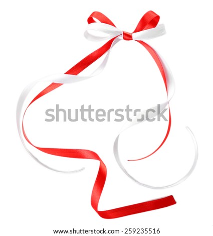Colorful red and white ribbons with bow isolated on white - stock photo