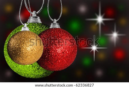 Colorful red, green and gold christmas decorations on strings - stock photo