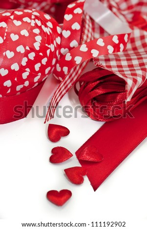 Colorful red ribbons and hearts