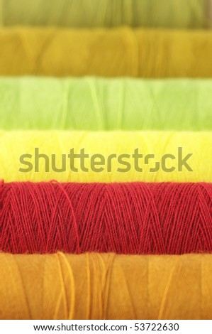 Colorful reels of thread close-up as background. - stock photo